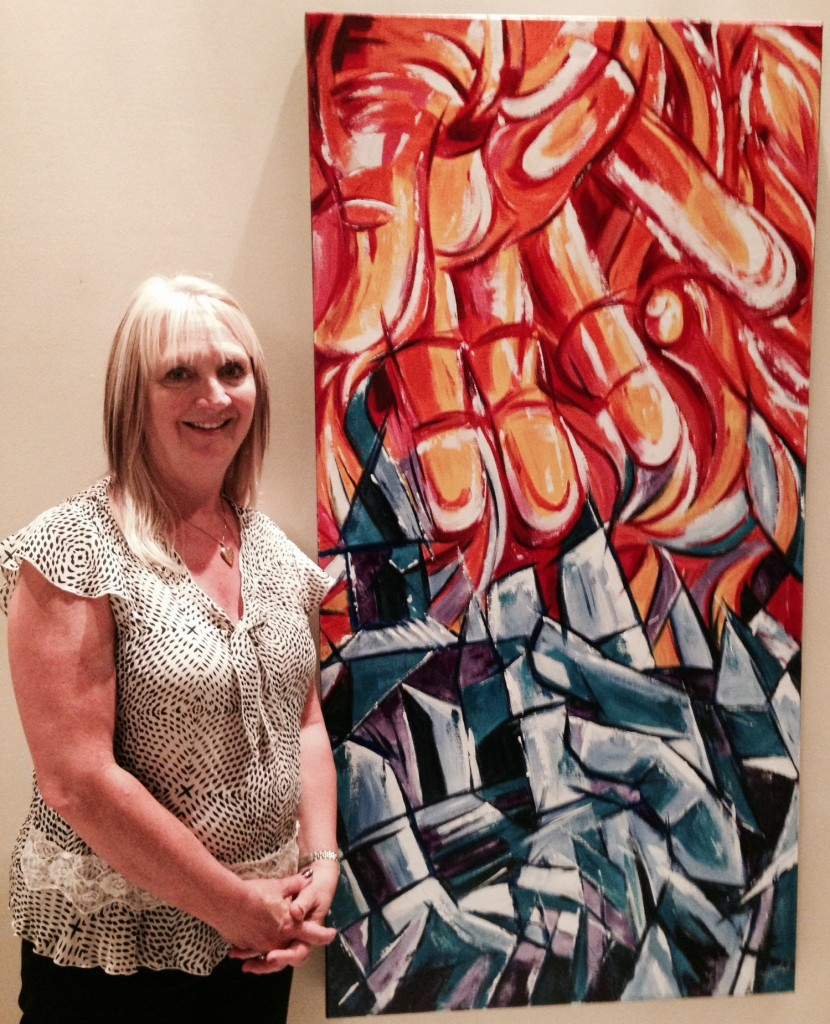 "Winnipeg Artist Faye Hall next to her painting ""Fire & Ice"""